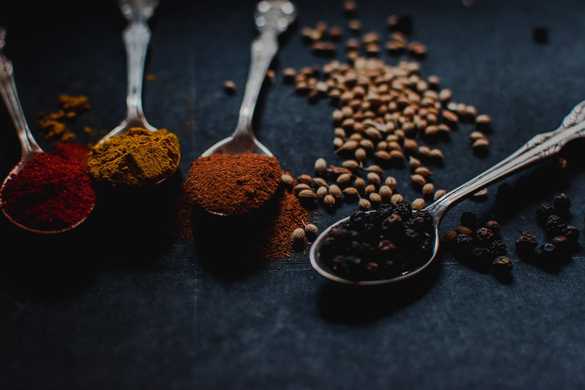 colourful spices in teaspoons
