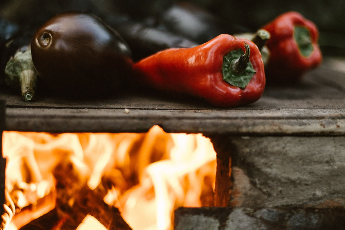 red peppers on a simple fire