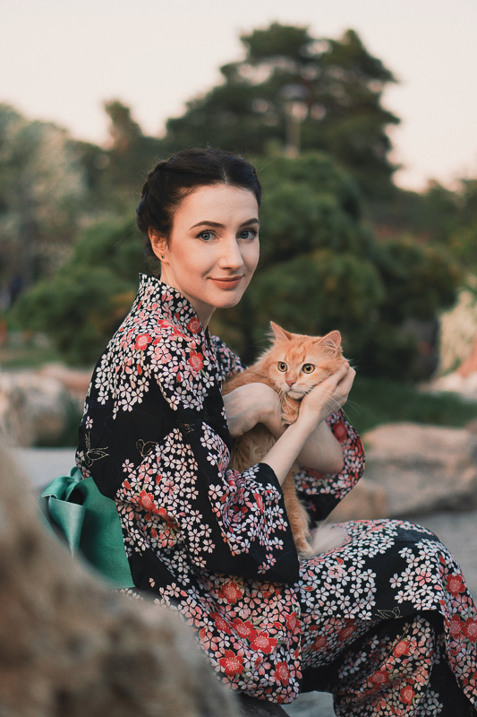woman in kimono with ginger cat